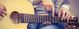Best songs to learn to improve guitar skills